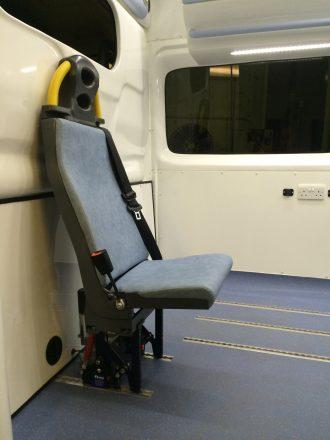 Rear Facing Attendant Seat